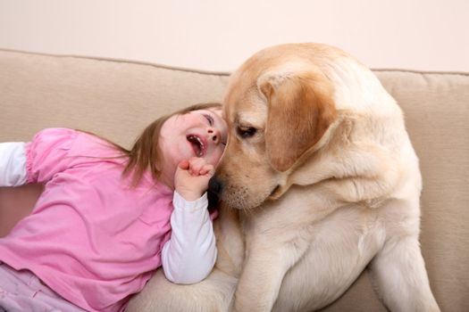 Dog therapy for girl with Down Syndrome.