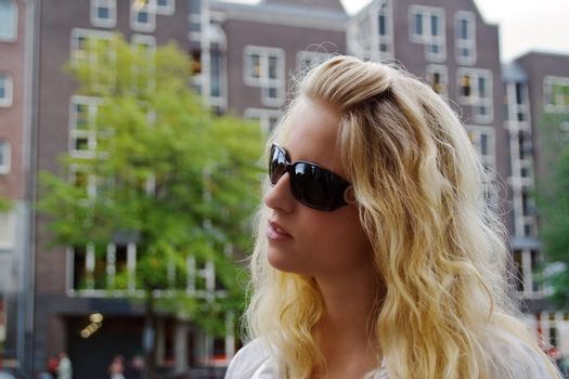 Portrait of a pretty blond girl on Amsterdam street