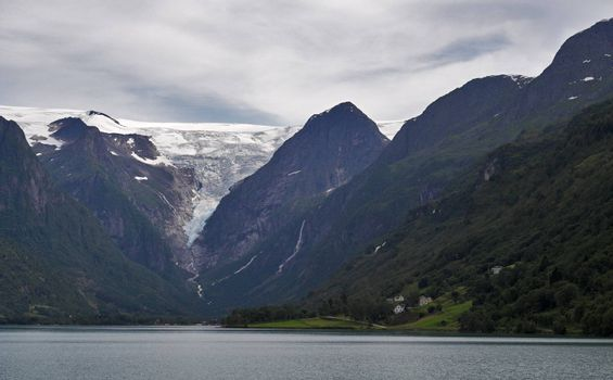 View at mountains and Briksdal glacier above the lake. Norway.