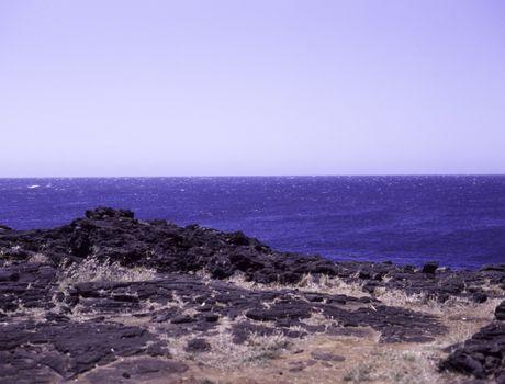The sea, with lava rocks on the west coast of Hawaii's Big Island