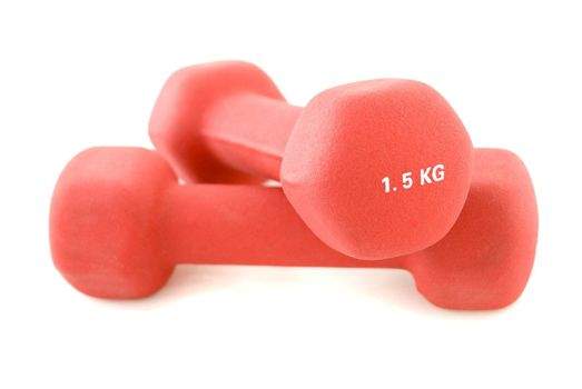 A pair of red dumbbells, isolated white