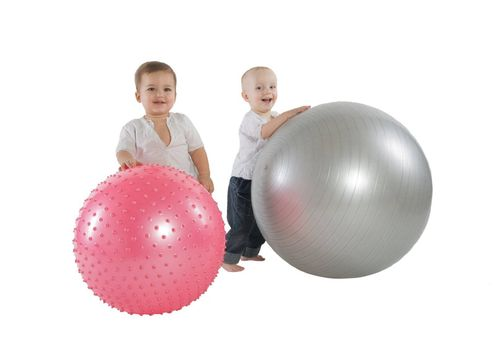 An isolated photo of two boys with fitness balls