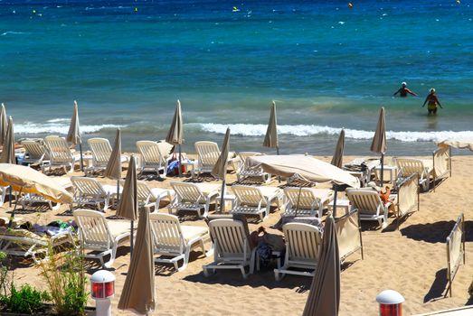Sandy beach along Croisette promenade in Cannes France
