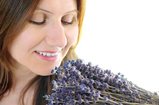 Mature woman smelling bunch of dried lavender
