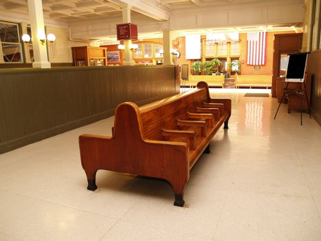 empty wood benches in an old indoor train station