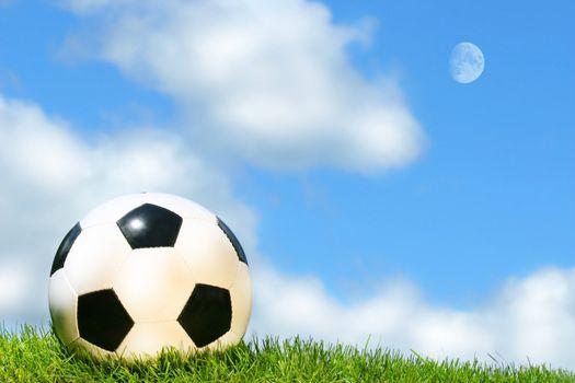 Soccerball against a blue sky