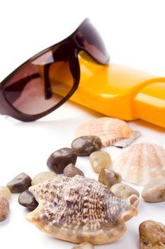 shells, sunglasses and lotion