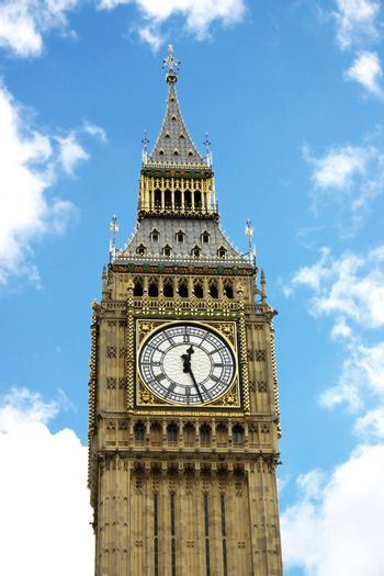 Big Ben with fluffy white clouds and blue sky