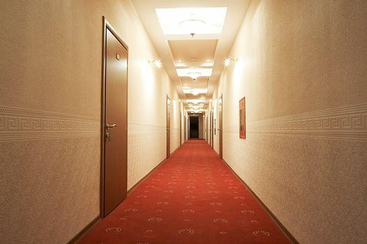 Beautiful and long corridor in modern hotel