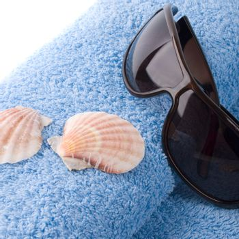 towel, shells, sunglasses