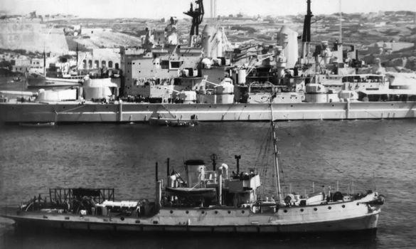 WWII Battleship and tug in Malta