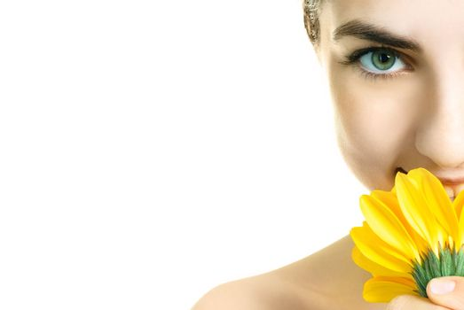 closeup of a pretty young woman with a yellow flower