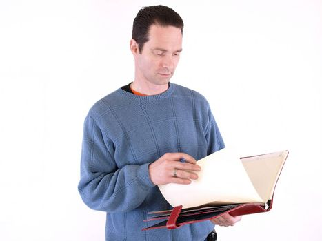 An adult male looking over notes in a binder, isolated against a white background.