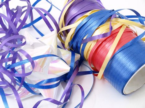 A tangle of colorful ribbons isolated against a white background.
