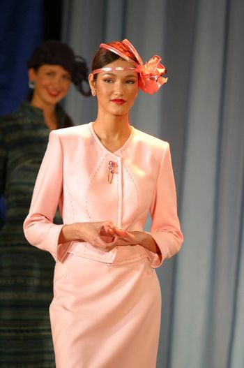 The international exhibition. The girl - model in a hat