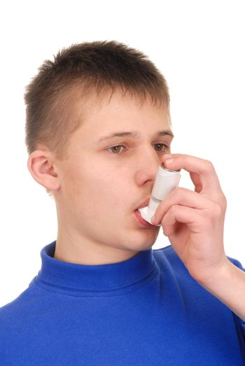 Teenager holding an inhaler isolated on white