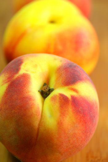 Peaches in vertical composition.