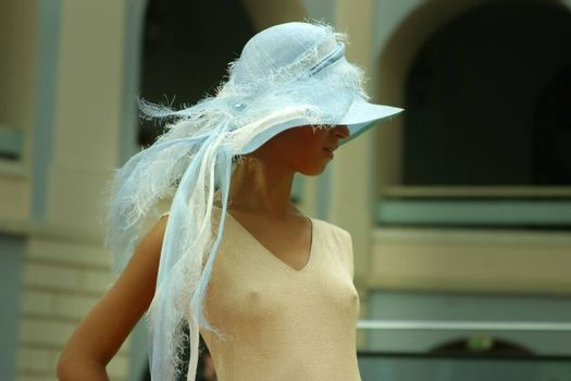 Model in a hat on fashion parade