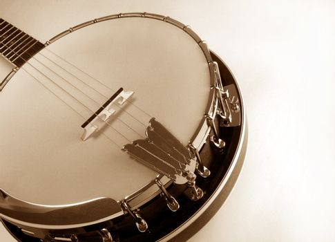 Banjo in sepia tone.