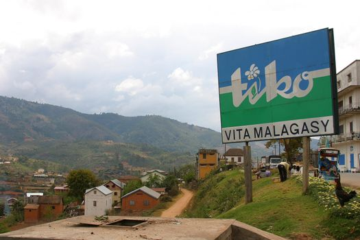 Malagassy landscape with a huge add for tiko water