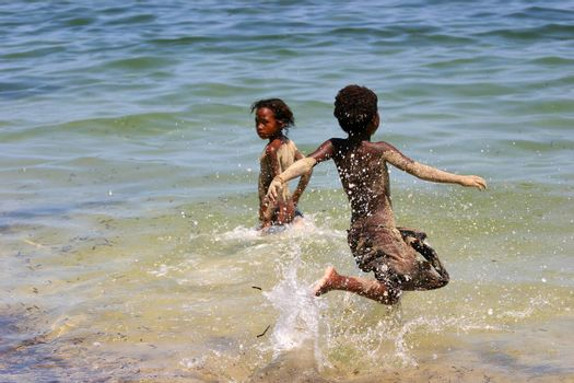 Children playing in the sea at Ifaty, Madagascar