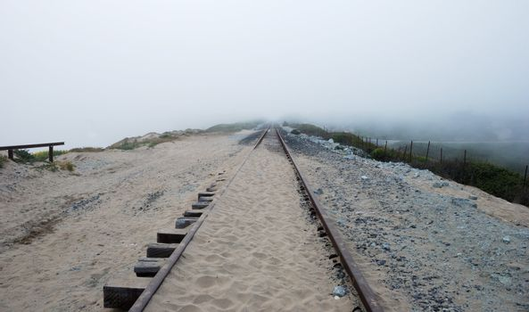 Railroad Disappearing in the Fog