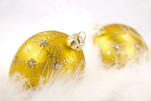 Gold balls with feathers