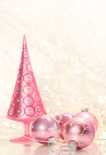 Pink holiday tree with glass balls and simmering background