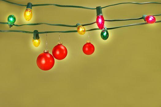 Christmas balls hanging on lights