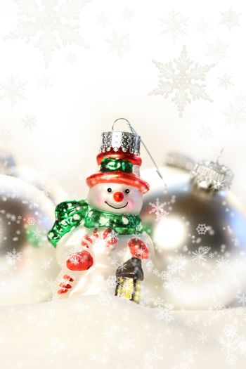 Little snowman ornament in the snow