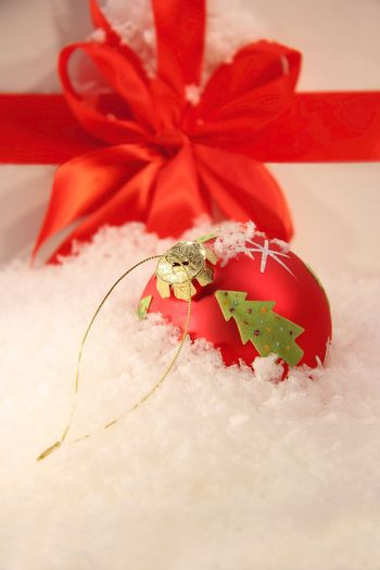Red Christmas ball in the snow