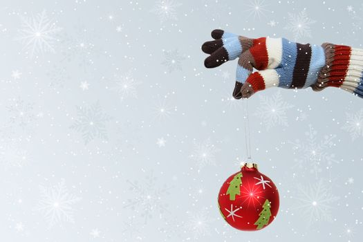 Winter mitten with Christmas ball
