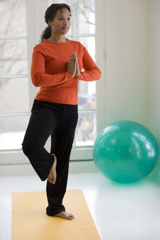Pretty black woman practicing yoga Pretty black woman practicing