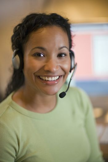 Smiling African American woman with earphones and microphone