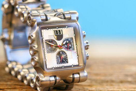 Wrist watch on wood