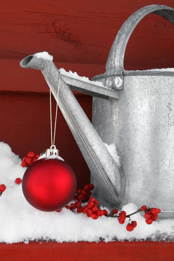 Red ornament on watering can