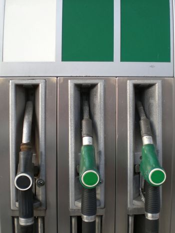 Detail of a gas / fuel  /petrol filling station, with green tabs for biofuel