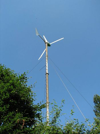 Small windmill on a farm, used to pump water, Germany, 2007