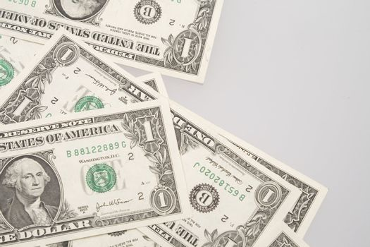 Isolated one dollar banknotes on a white background