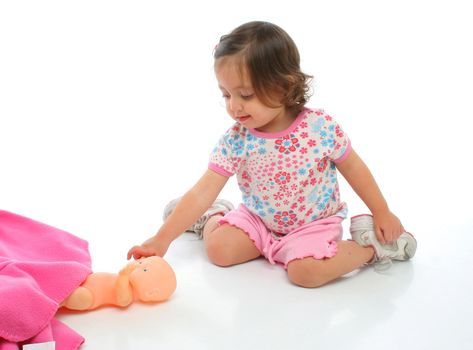 Beauty toddler playing with her baby toy. More pictures of this child at my gallery