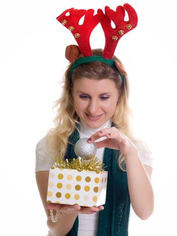 girl wearing a reindeer headband with a gift