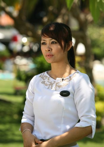 TV reporter presenting the news about Bali