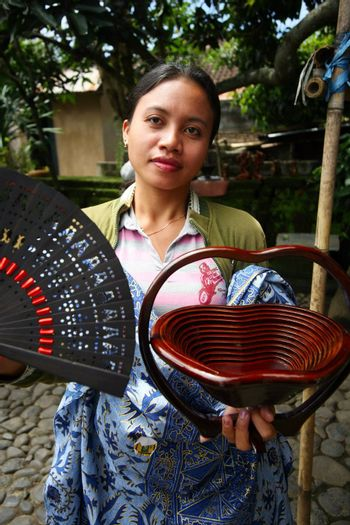 The Indonesian girl sells souvenirs. Bali
