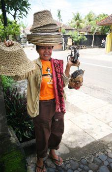 The Indonesian woman sells souvenirs. Bali
