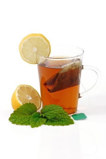 Peppermint tea in a glass on bright background