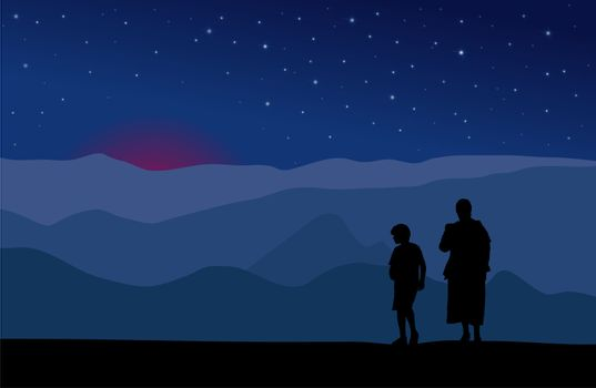 Mother and child watching sunset in mountains