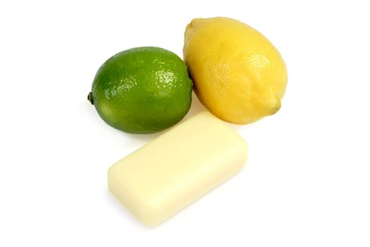 Yellow soap with lemon and lime on white background
