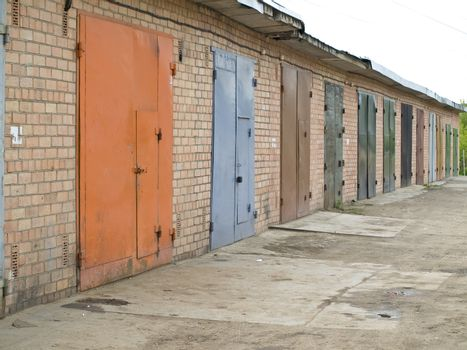 row of garage with multicolored metalic doors