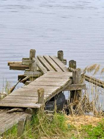 Wooden planked footway at the lake in the nature