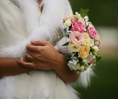 The bride holds a wedding bouquet